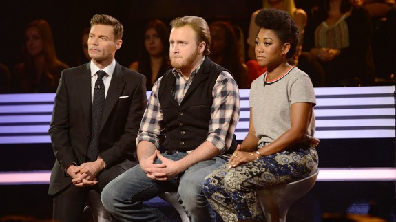 Ben and Majesty sit in the hot seats of the Bottom 3 next to Ryan Seacrest.