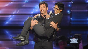 "Harry Connick, Jr. cradles Munfarid Zaidi as Zaidi sings Connick's ""Every Man Should Know."""